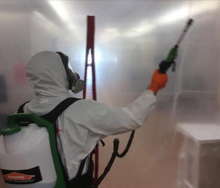 Man in PPE Cleaning a building in Cantonment, Florida