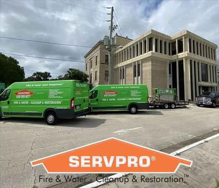 SERVPRO Vehicles In Front of a Large Building